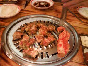 Samgyeopsal (and a lone kimchi leaf)