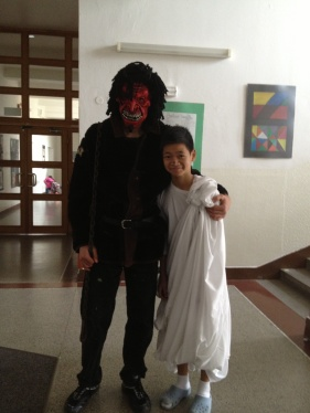 One of the less scary demons I encountered, who did not run at me, and only growled a little bit when I asked him to pose for a photo with a passing angel-boy.
