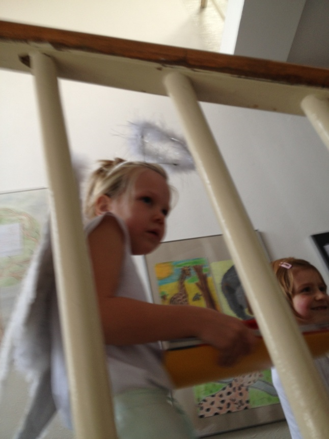 One of my adorable wee 1st grade angels, coming down the stairs after our class and promptly freaking out when she saw a mob of demons. She fled down the stairs, her little angel wings flying behind her...